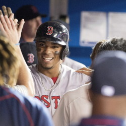 Red Sox shortstop Xander Bogaerts celebrates with teammates after hitting a home run in the sixth inning Saturday against the Toronto Blue Jays. The Red Sox won, 7-6.