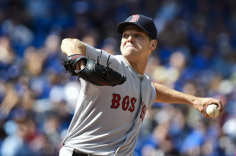 Red Sox starting pitcher Rich Hill struck out 10 batters in Boston's 4-3 win over Toronto on Sunday to earn his first win since July 14, 2013.