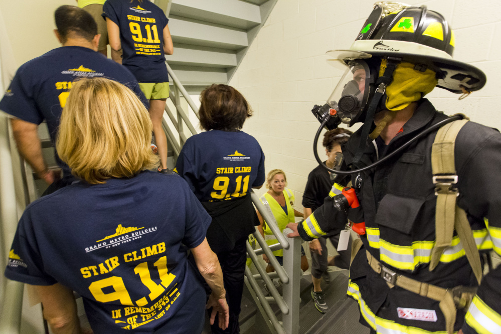 About 100 participants climbed the stairs at 2 Monument Square on Sunday to honor the firefighters who gave their lives on 9/11 and to raise money for the National Fallen Firefighters Foundation. They climbed to the top floor 10 times for a total of 110 flights – the number of floors in each of the Twin Towers.