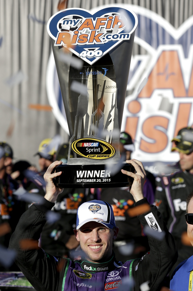 Denny Hamlin celebrates in Victory Lane after winning the NASCAR Sprint Cup race Sunday at Chicagoland Speedway in Joliet, Ill.