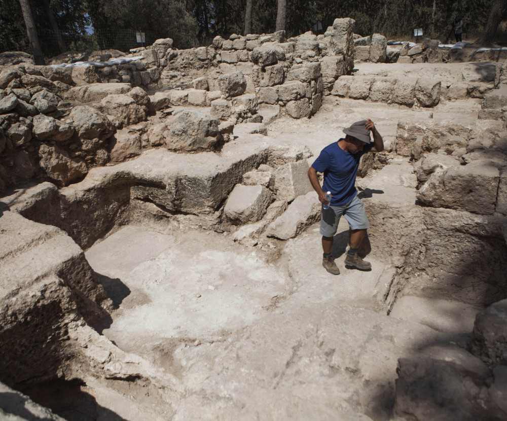 A worker for the Israel Antiquities Authority walks at an archeological site at Ben Shemen Forest near the Israeli city of Modiin. Israeli archaeologists may be one step closer to finding the location of the fabled tomb of the biblical Maccabees.