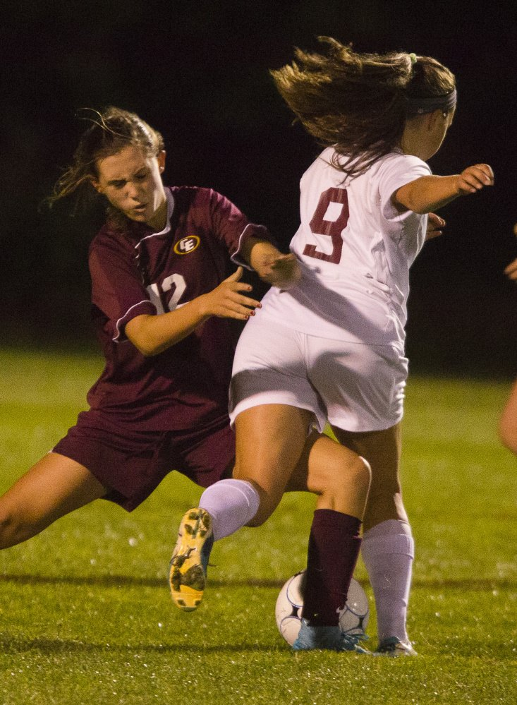 Cape Elizabeth's Grace Gillian steps in to play the ball in front of Greely's Elli Schad during the Rangers' 1-0 win Monday in Cumberland. Schad scored the lone goal of the game in the second half.