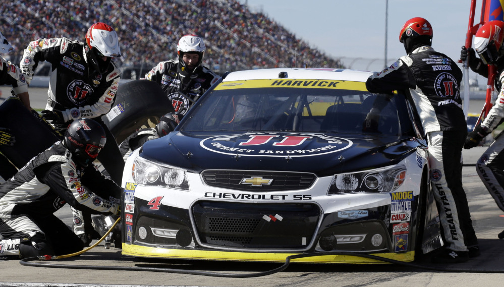Kevin Harvick, seen making a pit stop during the Sprint Cup race Sunday at Chicagoland Speedway, could help himself by settling a dust-up with longtime friend Jimmie Johnson.