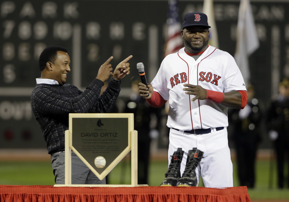 Pedro Martinez smiles and points toward David Ortiz as Ortiz takes the microphone during pregame ceremonies Monday honoring his 500 career home runs.
