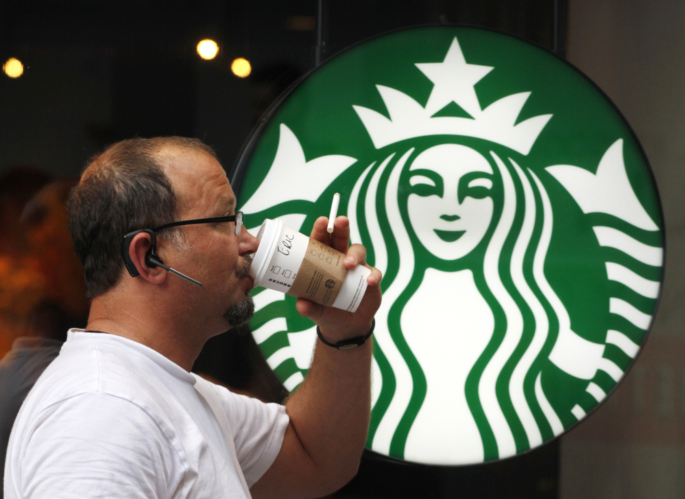 A man drinks a Starbucks beverage in New York.