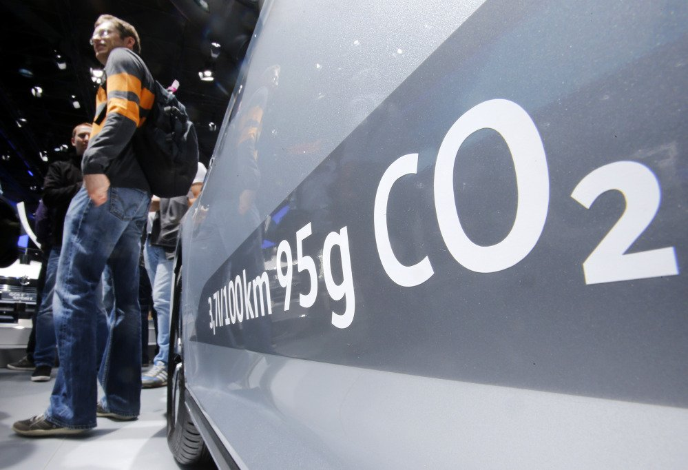 The amount of carbon dioxide emission is written on a Volkswagen Passat Diesel at the Frankfurt Car Show in Frankfurt, Germany, Tuesday, Sept. 22, 2015.