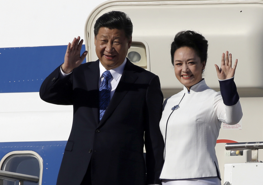 Chinese President Xi Jinping and his wife, Peng Liyuan, arrive Tuesday at Boeing Field in Everett, Wash. Xi is spending three days in Seattle before traveling to Washington, D.C., for a White House state dinner on Friday.