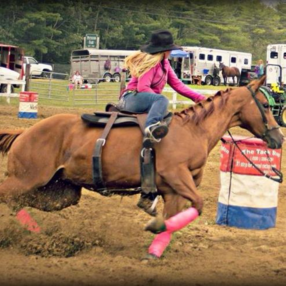 Halee Cummings competes in a barrel race. The teen, who died in an ATV accident Friday, loved horses and competition.