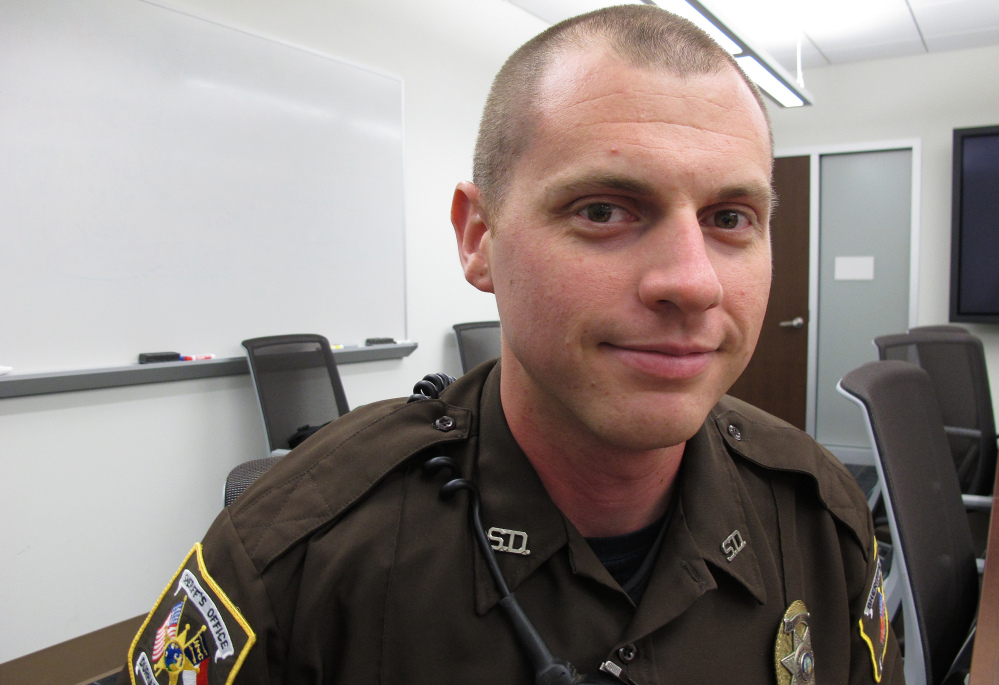 "Durham (N.C.) County Sheriff's Deputy David Earp, who pulled two young children from a pond Sunday, said Tuesday he was just focused on one thing, trying to save the grils who were tossed into the pond by their father. ""It plays over in my mind a lot, as I'm sure with any person,"" he said"