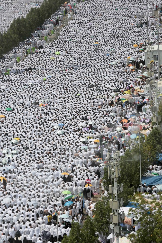 Hundreds of thousands of Muslim pilgrims pray outside Namira mosque in Arafat, on the second and most significant day of the annual hajj pilgrimage, near the holy city of Mecca, Saudi Arabia, on Wednesday.