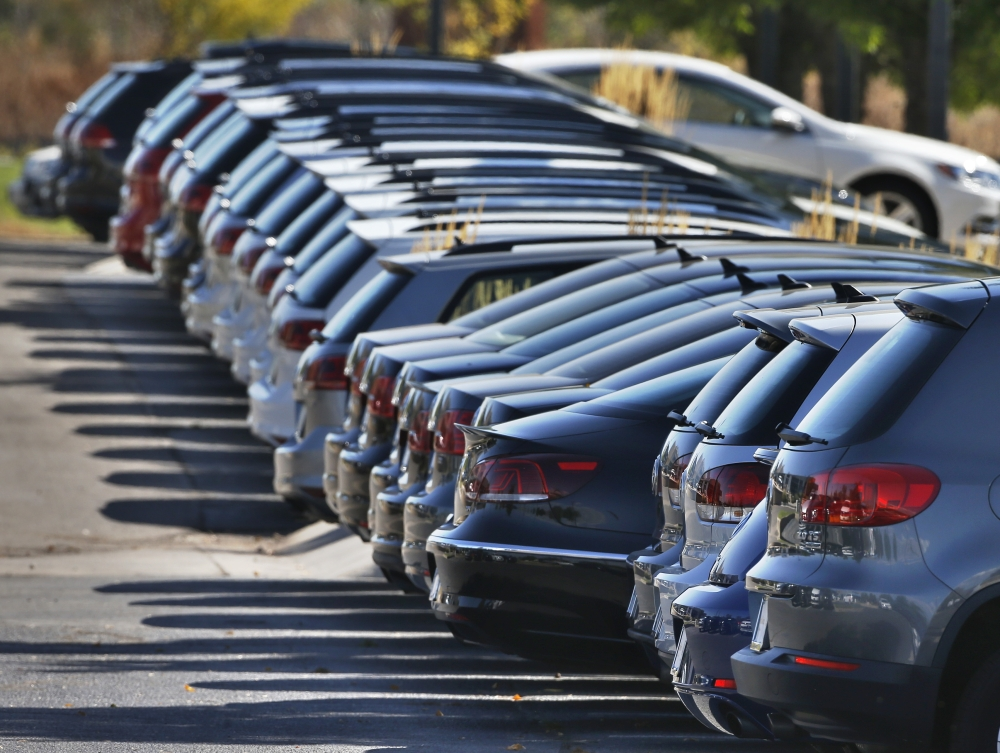 Volkswagen cars are displayed for sale on the lot of a VW dealership in Boulder, Colo., on Thursday. Volkswagen is reeling days after it became public that the German company had rigged diesel emissions software to pass U.S. tests.