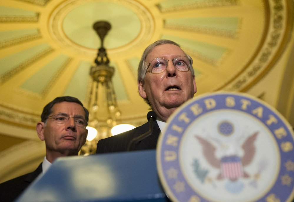 Senate Majority Leader Mitch McConnell has offered a bipartisan stopgap bill free of the Planned Parenthood issue that's expected to clear the Senate next week. In the background is Wyoming Republican John Barrasso.