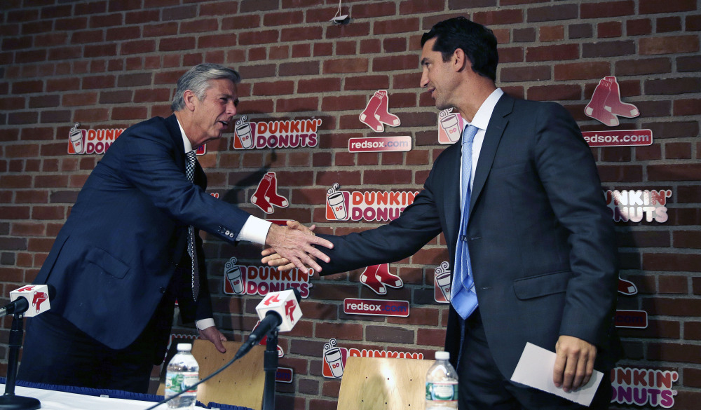 Mike Hazen, right, is the new general manager and senior vice president for the Boston Red Sox. The appointment is the first big move by Dave Dombrowski, left, since he took over as president of baseball operations for the team in August. The Associated Press