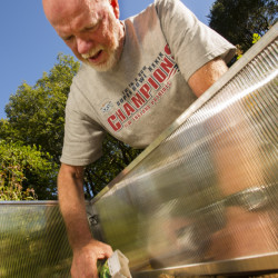 Tom Atwell plants carrots, lettuce and beets in a cold frame, a portable greenhouse that enables gardeners to extend the planting season.