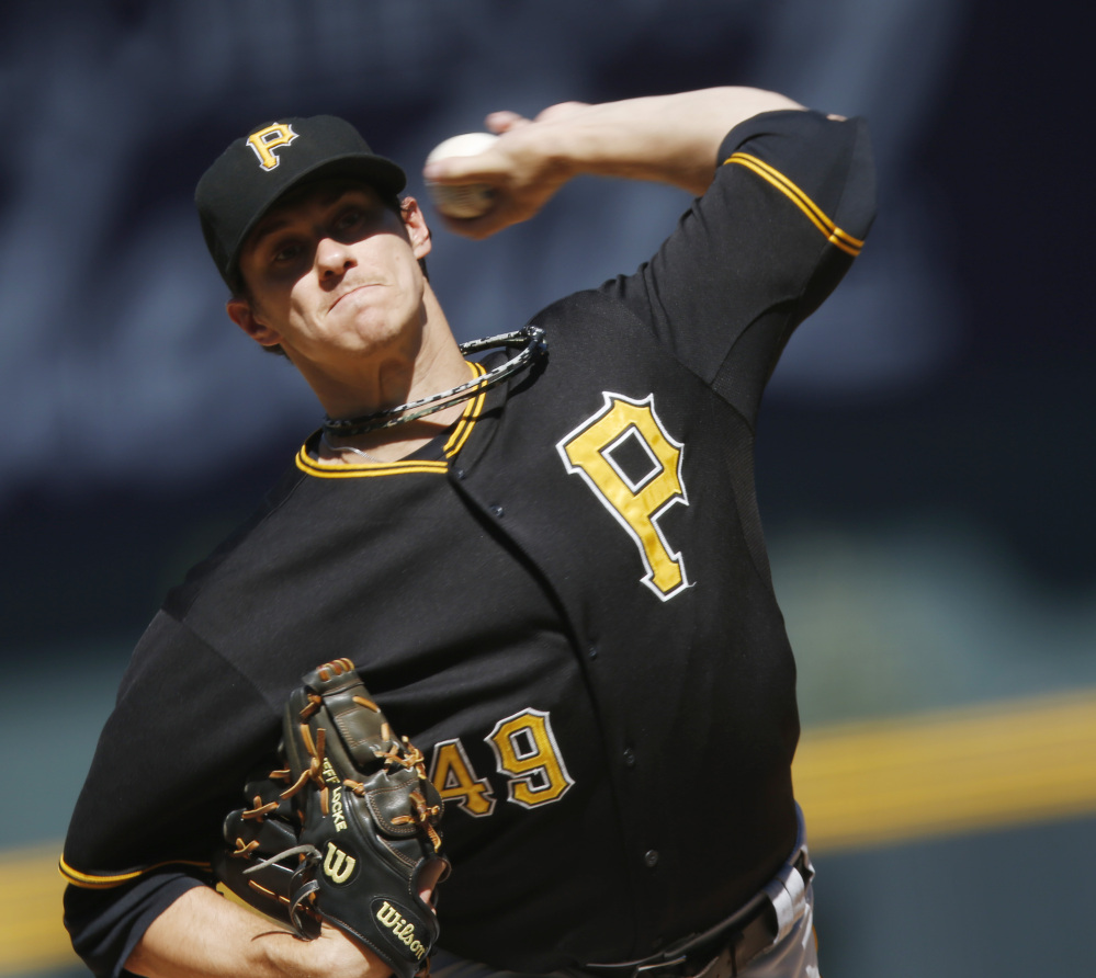 Jeff Locke of the Pirates delivers a pitch in Thursday's 5-4 win over the Colorado Rockies in Denver – Pittsburgh's 10,000th career victory.