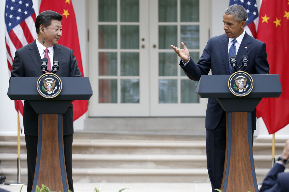 President Barack Obama and Chinese President Xi Jinping hold a joint news conference in the Rose Garden of the White House in Washington on Friday.