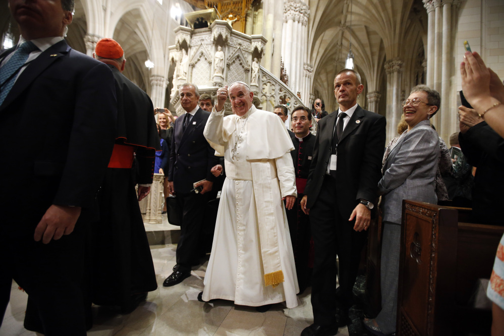 Pope Francis gives a thumbs up after leading an evening prayer service at St. Patrick's Cathedral in New York on Thursday. The pontiff has the wisdom to avoid creating unnecessary wedges, a letter writer says.