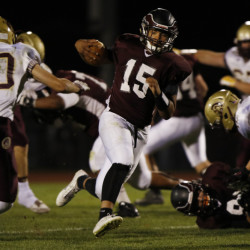 WINDHAM, ME -SEPTEMBER 25: Windham quarterback Desmond Leslie, center, runs the ball during the first quarter of their game against Thornton Academy Friday, September 25, 2015 in Windham, Maine. (Photo by Joel Page/Staff Photographer)