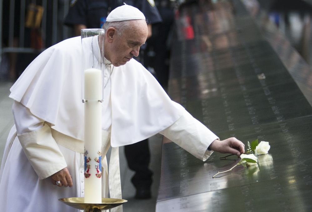 Pope Francis places a white rose at the South Pool of the 9/11 Memorial in downtown Manhattan on Friday. Francis said a prayer of remembrance at an interfaith ceremony at the museum in New York. The pontiff asked God for eternal peace for those killed, as well as healing for the relatives of the nearly 3,000 people killed in the 2001 terror attacks in New York, at the Pentagon and in a field in Pennsylvania.