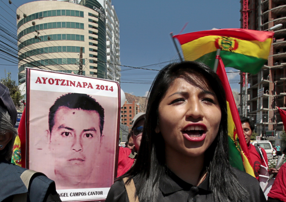 Eva Liz Morales, daughter of Bolivia's President Evo Morales, takes part in a Saturday protest in La Paz, Bolivia, about the 43 Mexican students who disappeared a year ago.