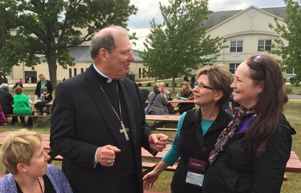Bishop Robert Deeley, head of the Roman Catholic Diocese of Portland, chats with pilgrims Vanessa Madore, left, Monica Cote and Nancy Grover, all of Saint Paul the Apostle Parish in Bangor, at the National Shrine of Our Lady of Czestochowa in Doylestown, Pa.