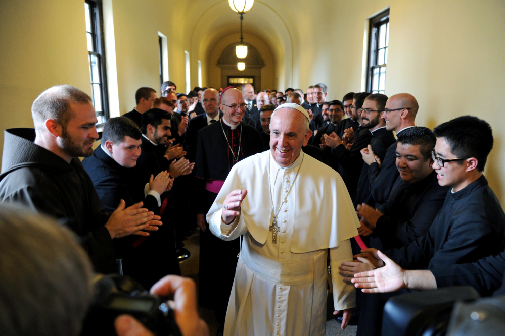 In this file photo, Pope Francis greets seminarians as he walks the loggia to his address to the Bishops at St. Martin of Tours Chapel at St.Charles Borromeo Seminary in Wynnewood, Pennsylvania.