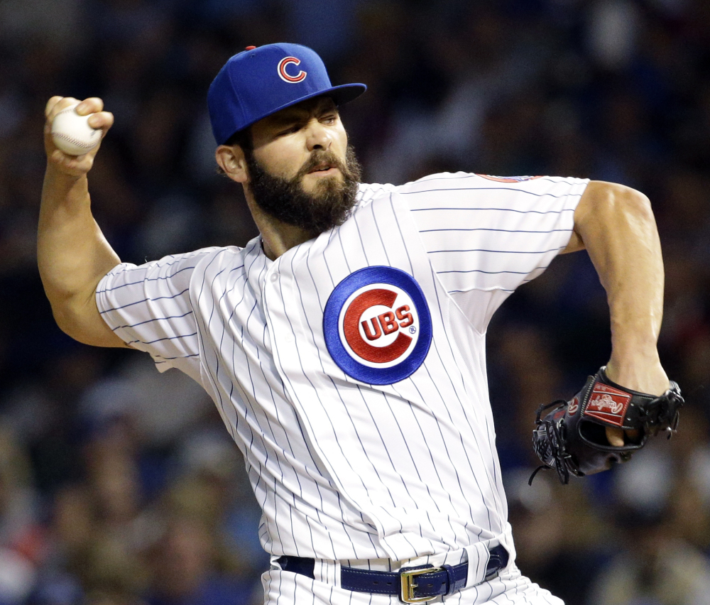 Jake Arrieta, who didn't allow a base runner until the seventh inning, pitched seven scoreless innings as the Cubs beat the Pirates 4-0 Sunday in Chicago.