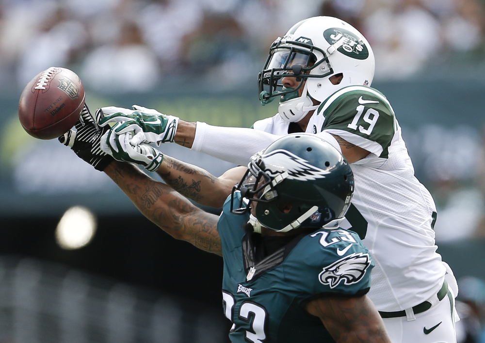 Eagles cornerback Nolan Carroll, front, breaks up a pass intended for Jets wide receiver Devin Smith during Philadelphia's 24-17 win Sunday in East Rutherford, N.J.