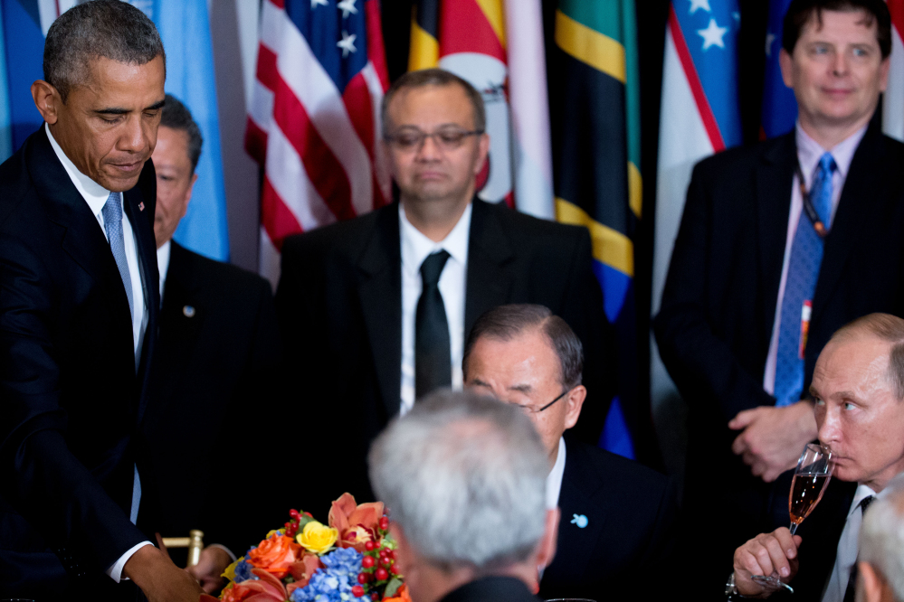 President Obama and Russian President President Vladimir Putin, bottom right, attend a luncheon hosted by United Nations Secretary-General Ban Ki-moon, center, on Monday at United Nations headquarters.