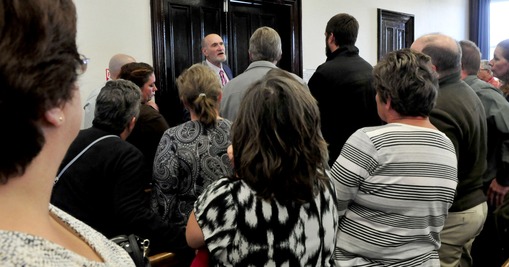 Defense attorney Leonard Sharon speaks with family and friends who filled the Somerset County Superior Court in Skowhegan on Monday, following the sentencing of Andrew Maderios on domestic violence charges.