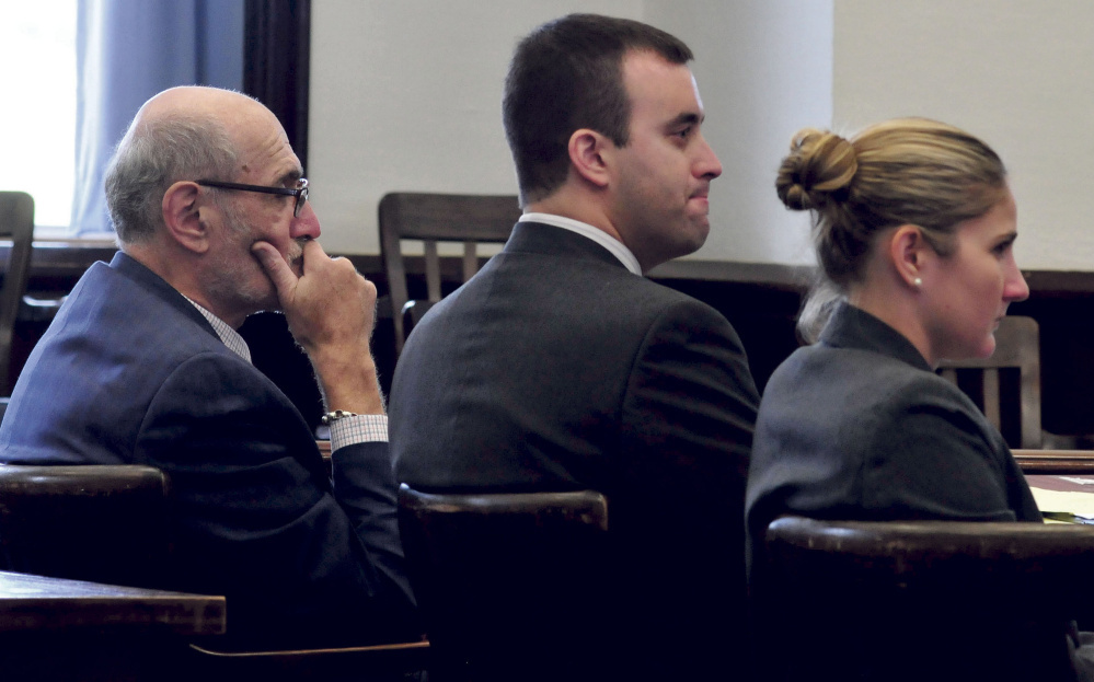 Andrew Maderios, center, and his attorneys Leonard Sharon and Caleigh Milton, listen to the victim make statements at Maderios' sentencing hearing Monday in Somerset County Superior Court.