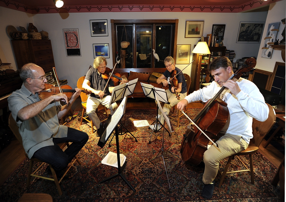 Members of the Portland String Quartet rehearse with new cellist, Patrick Owen. From left are: Dean Stein, first violin; Ronald Lantz, second violin; Julia Adams, viola; and Owen.  Gordon Chibroski/Staff Photographer