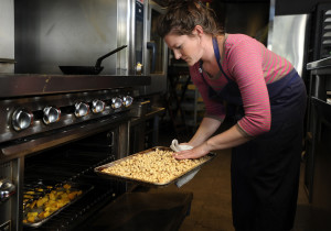 Kim Rogers, a chef at Hugo's Restaurant in Portland, roasts hazelnuts for use in a special recipe. Gordon Chibroski/Staff Photographer