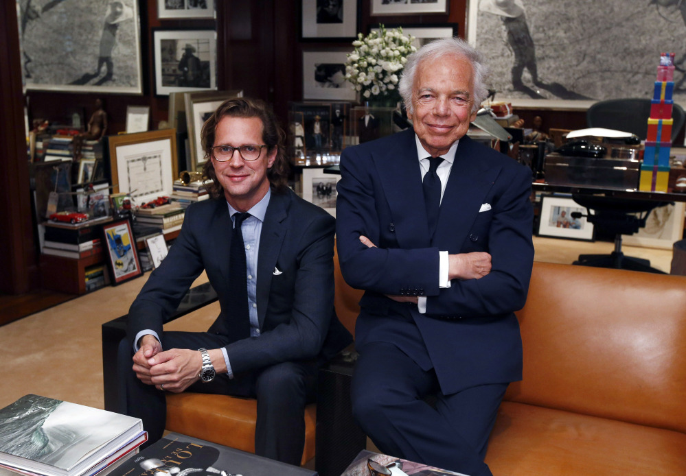 In his midtown Manhattan office, fashion designer Ralph Lauren, right, emphasized that stepping down as CEO does not mean he's slowing down, and said he sees incoming CEO Stefan Larsson, left, as a partner in spearheading future sales growth.