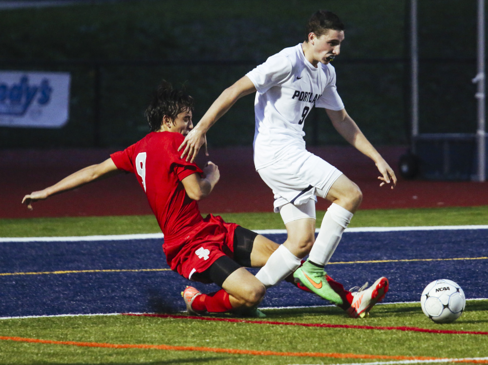 South Portland defender Patrick Graff attempts to gain possession of the ball while Portland player Alex Frank moves toward South Portland's goal at Fitzpatrick Stadium in Portland on Tuesday. Whitney Hayward/Staff Photographer