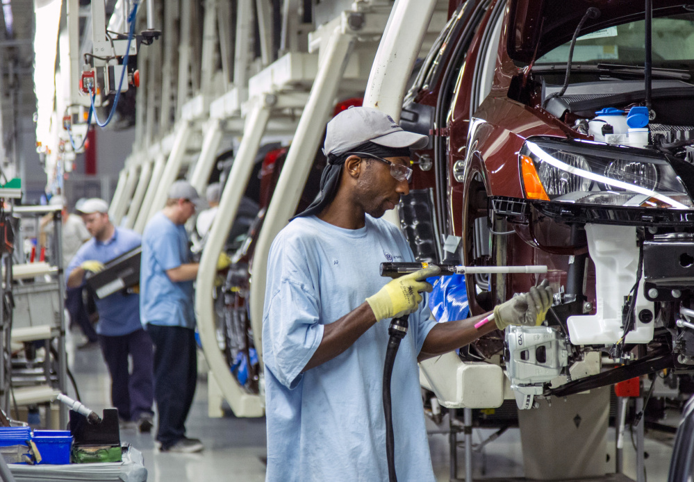 Workers at the Volkswagen plant in Chattanooga, Tenn., assemble Passat sedans. The full effect on demand for VW's non-diesel vehicles remains to be seen, but some Tennessee officials worry about the plant that currently employs 2,400.