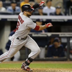 Boston's Deven Marrero drives in the go-ahead run in the 11th inning of Wednesday night's game against the Yankees.