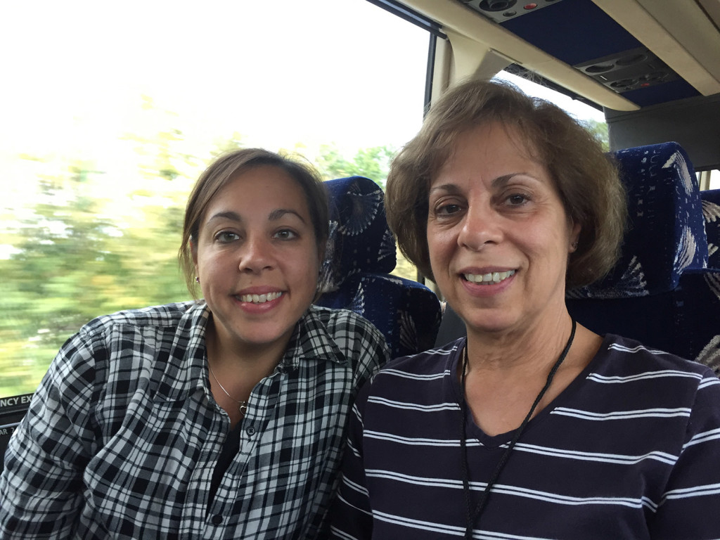 Lauren Stone of Westbrook and Lorraine Auclair of Greenville, daughter and mother, ride the bus Friday on their way to see Pope Francis this weekend in Philadelphia.