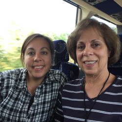 "Lauren Stone of Westbrook and Lorraine Auclair of Greenville, daughter and mother, ride the bus Friday on their way to see Pope Francis this weekend in Philadelphia. ""Everything is so mean and scary in the world,"" Stone said, ""and Pope Francis is so kind and caring."""