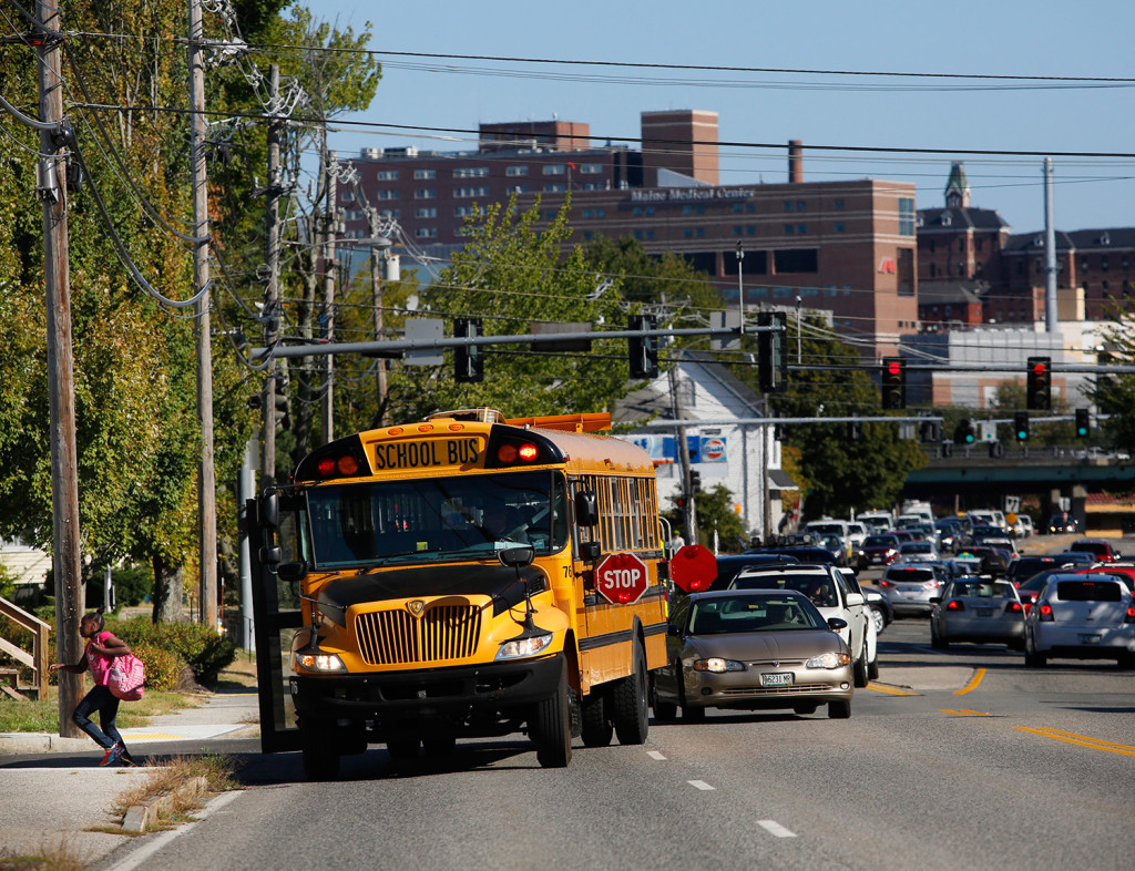 A school bus lets off a student at the corner of Congress and Frances streets on Thursday. Derek Davis/Staff Photographer