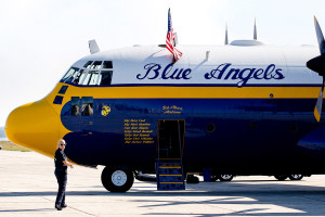 """Katy MacDonald, a public affairs officer with the Blue Angels, makes her way to """"Fat Albert,"""" an 80,000-pound C-130T that is part of the Blue Angels crew."""
