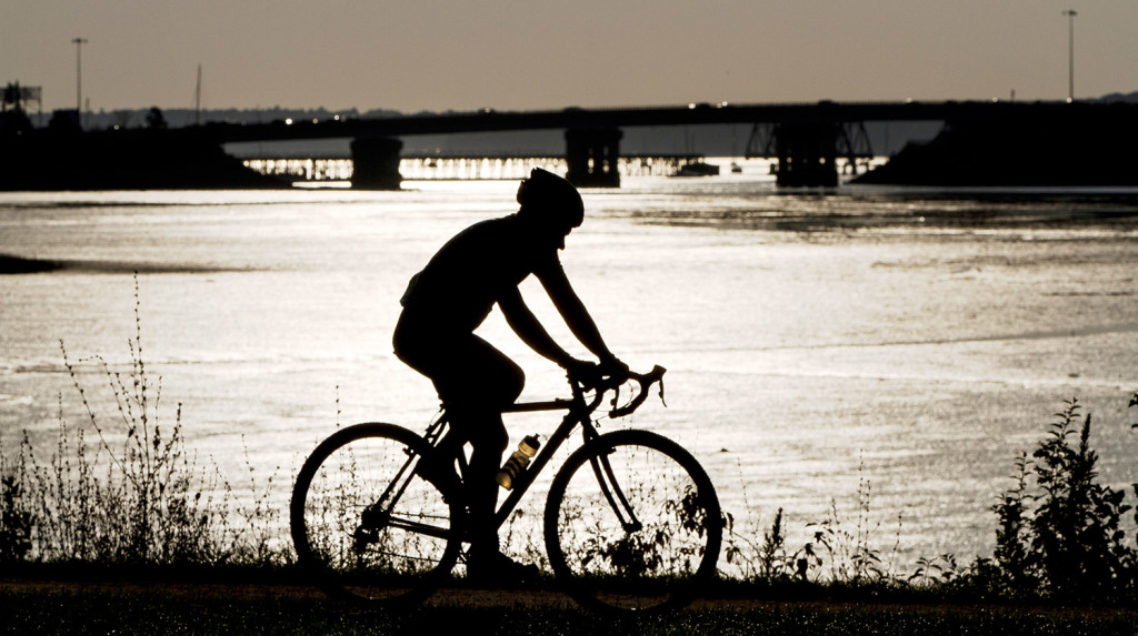 In this 2015 file photo, a cyclist speeds along the Back Cove Trail in Portland.