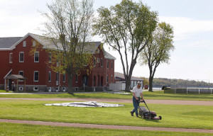 SOUTH PORTLAND, ME - MAY 20: Dave Dwinal, of the Southern Maine Community College grounds crew, mows the infield of the baseball diamond Wednesday, May 20, 2015 in South Portland, Maine. (Photo by Joel Page/Staff Photographer)