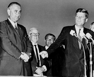 U.S. President John F. Kennedy, right, turns to introduce Vice President Lyndon B. Johnson to the crowd gathered to welcome the president and his party at Houston International Airport, Texas, on Sept. 11, 1962. The Associated Press