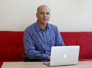 """Andrew Rosenstein owns TechPort on Temple Street in Portland. """"We have access to all of Apple's training and we can talk to Apple's engineers. That keeps us current,"""" he said."""