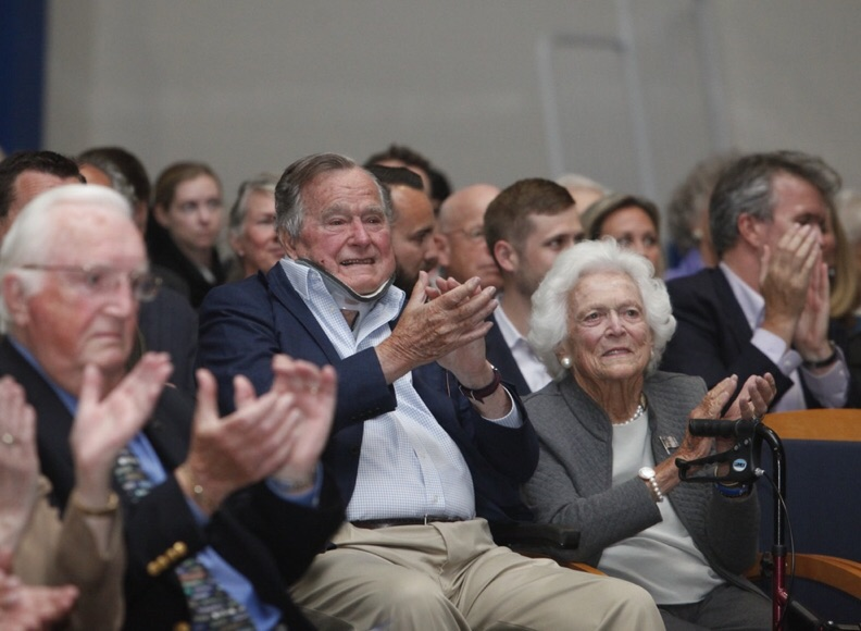 "Former President George H.W. Bush and Barbara Bush applaud while attending a lecture by TIME magazine editors Nancy Gibbs and Michael Duffy as part of the University of New England's George and Barbara Bush Distinguished Lecture Series in Biddeford on Thursday. The lecture was titled ""The Presidents Club: Inside the World's Most Exclusive Fraternity."" Bush, 91, is still wearing a brace while he recovers from a broken neck bone suffered in a fall in July."