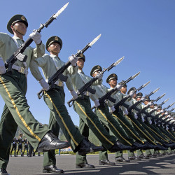 Chinese troops practice marching ahead of  Thursday's military parade at a camp on the outskirts of Beijing. The Associated Press