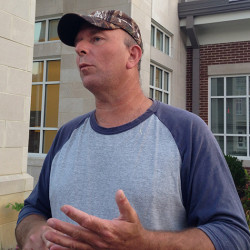 Joe Davis, husband of jailed Rowan County Clerk Kim Davis, speaks to reporters outside the Rowan County Courthouse on Friday, Sept. 4, 2015 in Morehead, Ky.   Davis says his wife  won't resign and will stay in jail for as long as it takes.  A federal district court judge jailed Kim Davis on Thursday for refusing to obey his order that she issue marriage licenses to gay couples (AP Photo/Bernard McGhee)