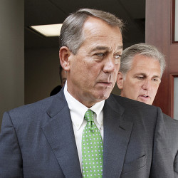 House Speaker John Boehner of Ohio, followed by House Majority Leader Kevin McCarthy of California, emerges from a meeting on Capitol Hill in this 2014 photo. The Associated Press