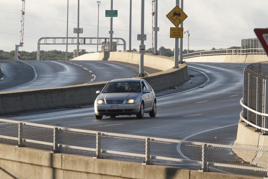 A car drives the wrong way back off the Casco Bay Bridge after being turned back by police early on Monday morning. Officers had closed the bridge to traffic after a man on the bridge had threatened suicide.